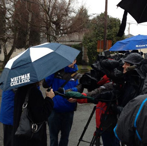 Deborah Kafoury '89 being interviewed by the media. Notice the Whitman College umbrella.