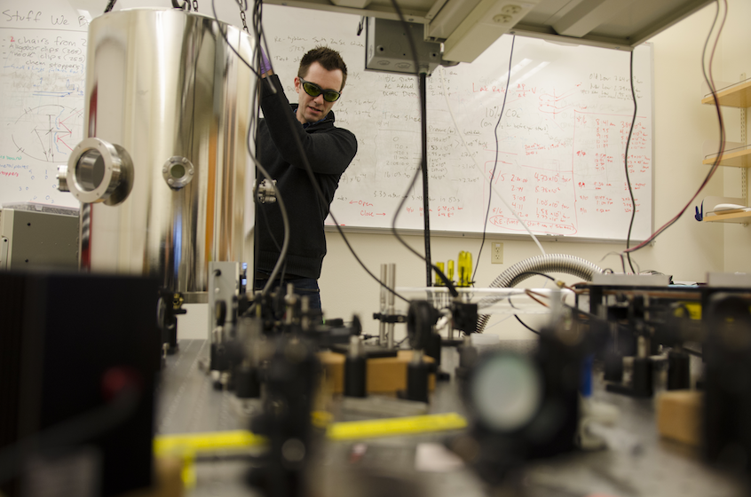 Assistant Professor of Physics Greg Ogin conducting precision optics research.