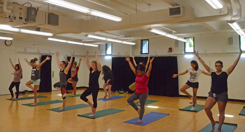 WISE participants practice yoga poses with an instructor from Walla Walla's Revolver Yoga Studio.