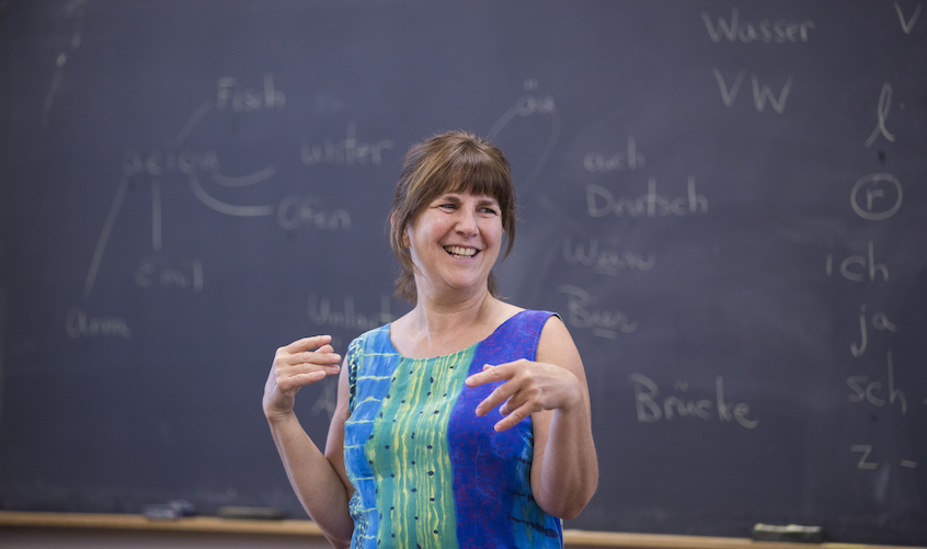 Senior Adjunct Assistant Professor of Foreign Languages & Literatures (German) Susan Babilon sings the alphabet in German with her Elementary German students.