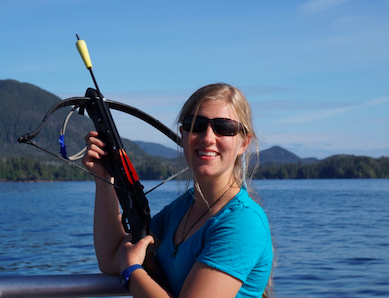 Baker in the Sitka Sound with a biopsy crossbow, a scientific instrument used to analyze genetic samples of whale skin and blubber with minimal invasion. Photo courtesy of Nevé Baker.