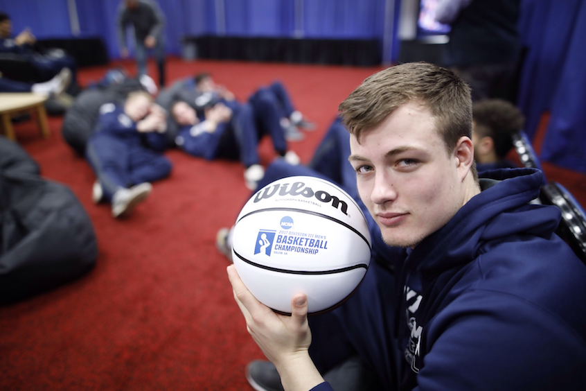 Robert Colton '19, a wing player and economics major, poses with a keepsake.