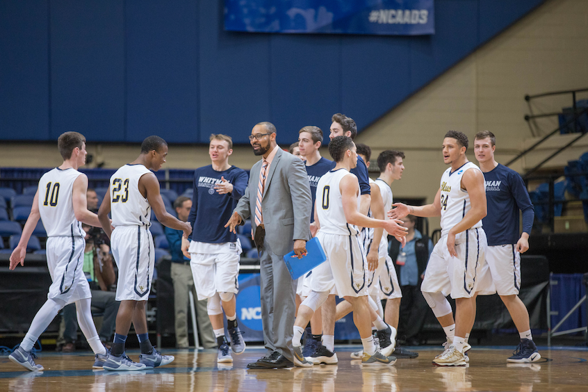 Assistant Men's Basketball Coach Stephen Garnett (center) congratulated good play early into the action.