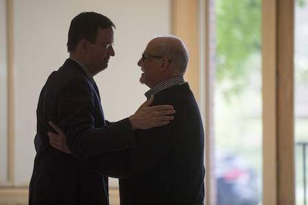 Cleveland and Peter Harvey '84, chief financial officer, share a private moment.
