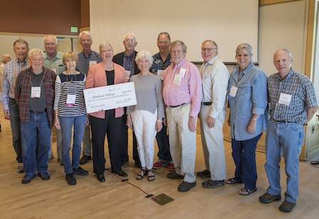 Class of 1967 co-chairs commemorate their $1 million gift with President Murray (holding check).