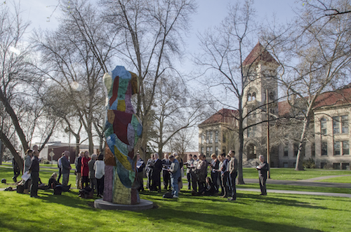 "Participants engage in a Heideggerian interpretation of Jim Dine's ""Carnival"" in front of the 1997 sculpture on the Whitman campus."