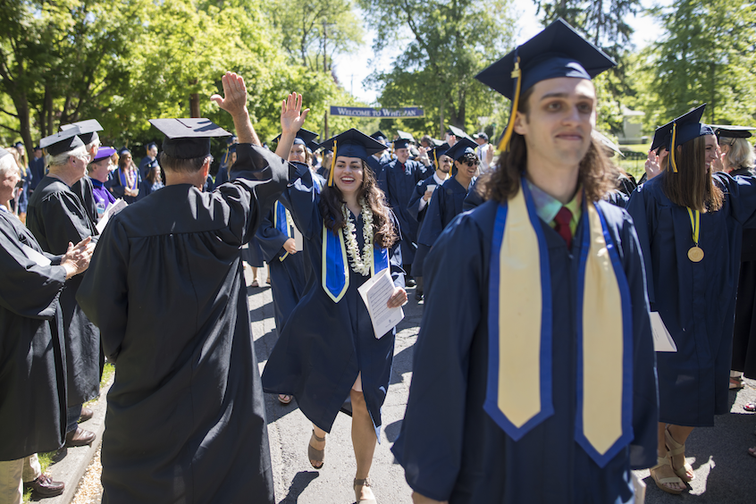 Biology major Stacie Bellairs '17 gets a high-five during the processional.