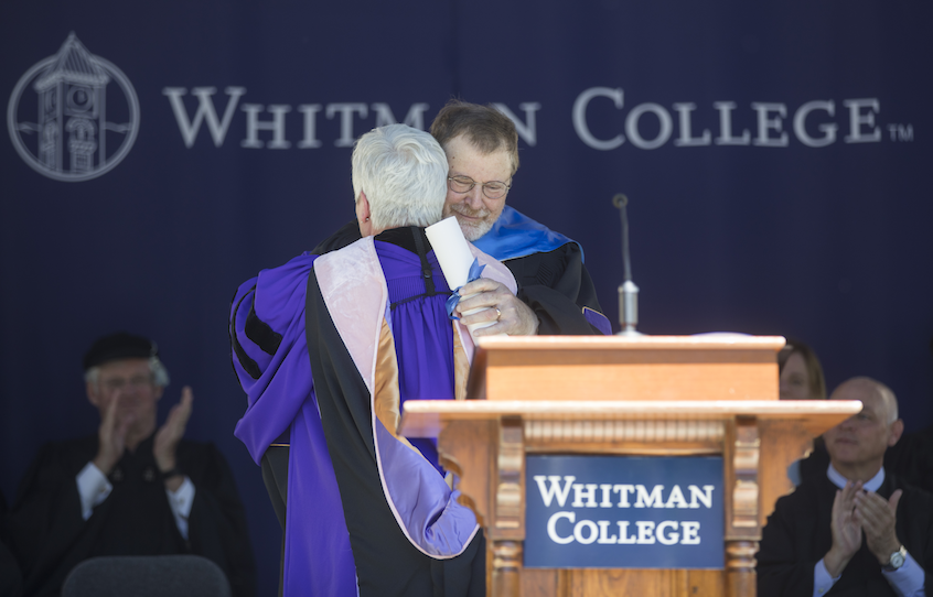 President Kathleen Murray embraces honorary degree recipient James Robart '69, United States District Court Judge for the Western District of Washington.
