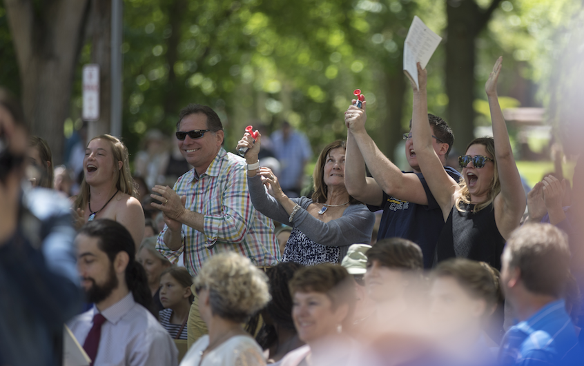 Family and friends cheer on the graduates during Whitman's Commencement ceremony on Sunday.