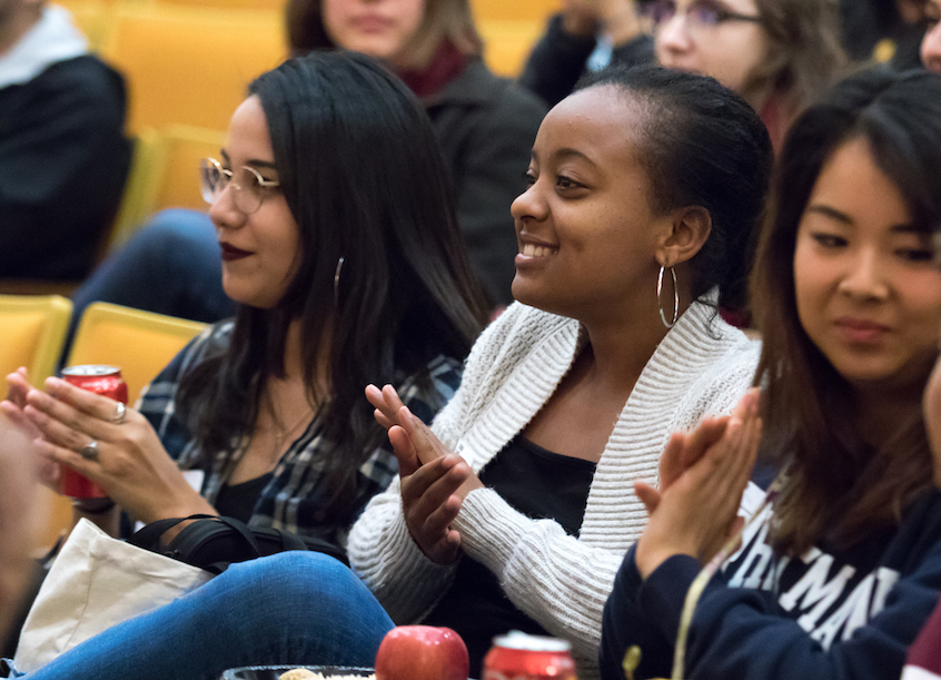 Left to right: Mayra Castaneda '19, a sociology major; Adyiam Kimbrough '19, a politics major; and Danielle Hirano '19, a rhetoric studies major, applaud a performance by the Testostertones, an all-male a cappella group at Whitman.
