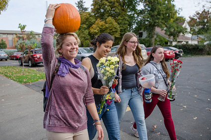 Four students gather supplies for this fall's Parents' Weekend.