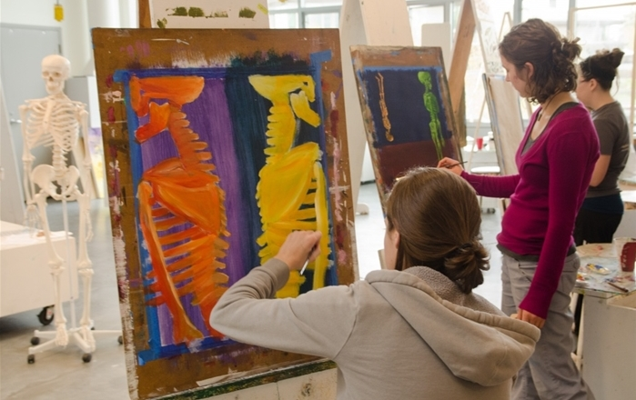 Students work on paintings in class