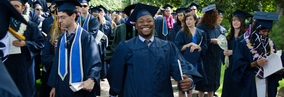Happy graduate at Commencement, 2014