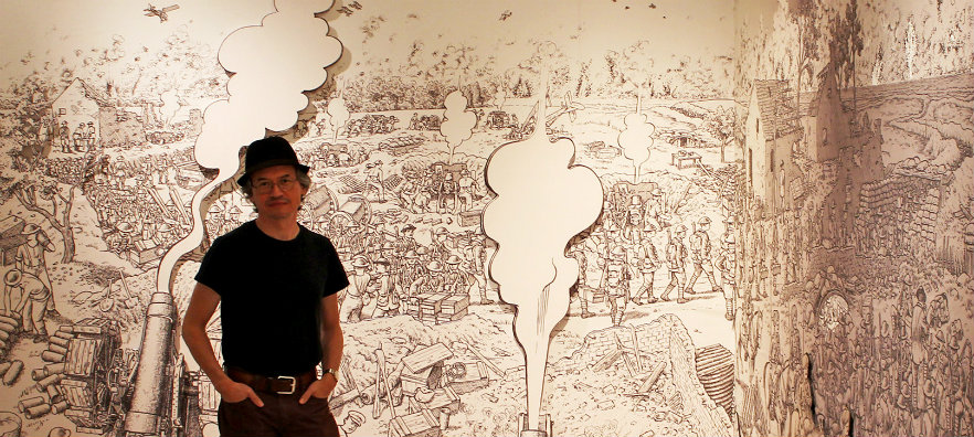 "Artist Joe Sacco with an image from his 2013 graphic novel, ""The Great War"""