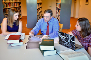 Schmitz with students in the library