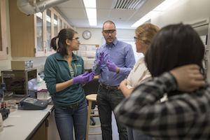 Assistant Professor of Chemistry Nate Boland explores ways to measure pH with students in his lab.