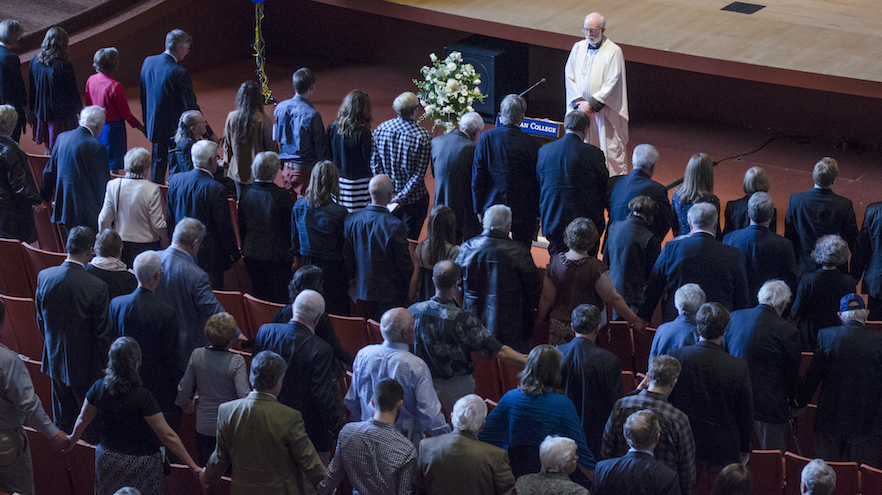 "Rev. Andrew Cooley, interim rector at St. Paul's Episcopal Church in Walla Walla, leads hundreds of attendees in prayer for the late Pete Reid, aka ""Mr. Whitman,"" last Saturday in Cordiner Hall."