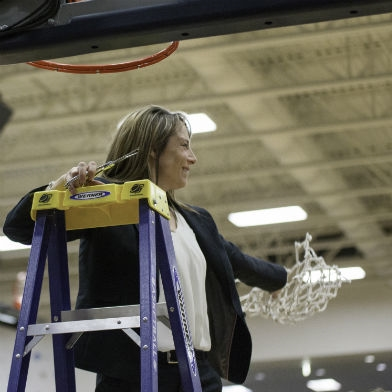 Whitman women's basketball coach Michelle Ferenz celebrates her 250th win