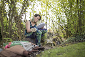 Nina Finley studies on campus near College Creek.