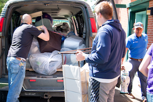 Cory Kiesz, custodial supervisor (left); Adam Dawson, resident director of the interest house community (center); and Carlos Ruiz, assistant custodial supervisor, load the college's custodial van with one type of care package after another from Whitman students for community members.