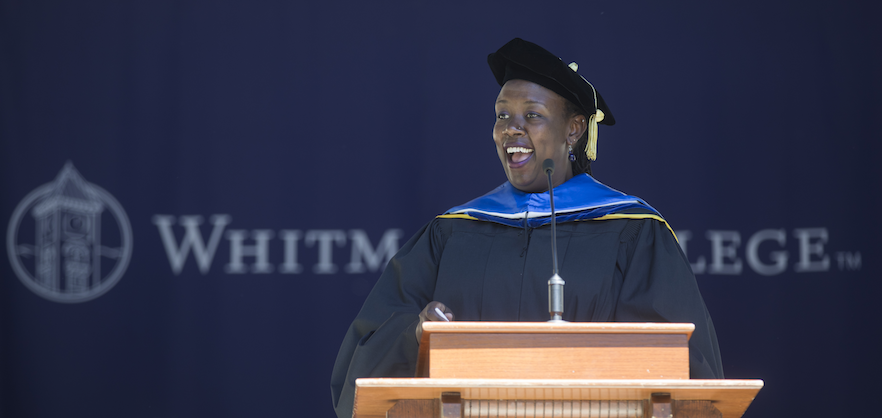 Wanjiru Kamau-Rutenberg '01 addresses the crowd during the college's 131st Commencement.