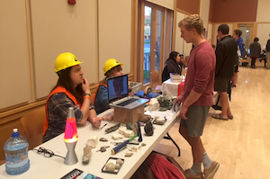 Chemistry and geology major Bryce Benson '18 (left) and geology major Molly Coates '17 represent the geology department at last year's fair. Photo by Nora Leitch '18.