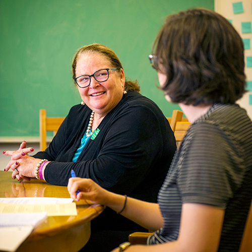 Chief Justice Mary Fairhurst talks with a student during a class at Whitman College Sept. 10, 2018.
