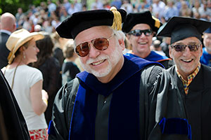 Keith Farrington smiles in the commencement line.