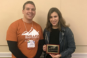 Maddy Gold '19 accepts the 2019 IMPACT Service Program of the Year award.
