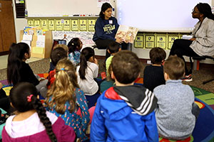 Whitman College students read a story to a group of first-graders.