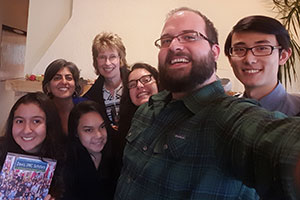 Kyle Martz stakes a selfie with a group of international students.
