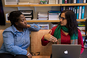 Laurinda Nyarko and Dalia Biswas go over research results.