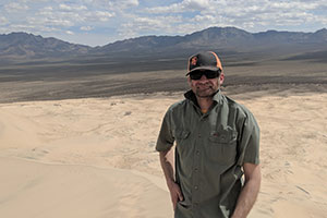 Lyman Persico stands in the Mojave Desert.