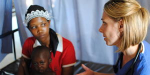Stephanie Van Dyke '99 with an Engeye Clinic patient