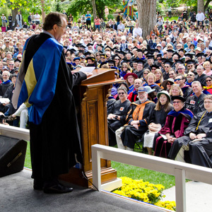 Eric Idle at the podium during Commencement 2013