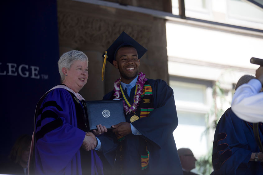 Whitman President Murray poses with Tray Foy, a biology major from Puget Sound, at the 2017 Commencement.