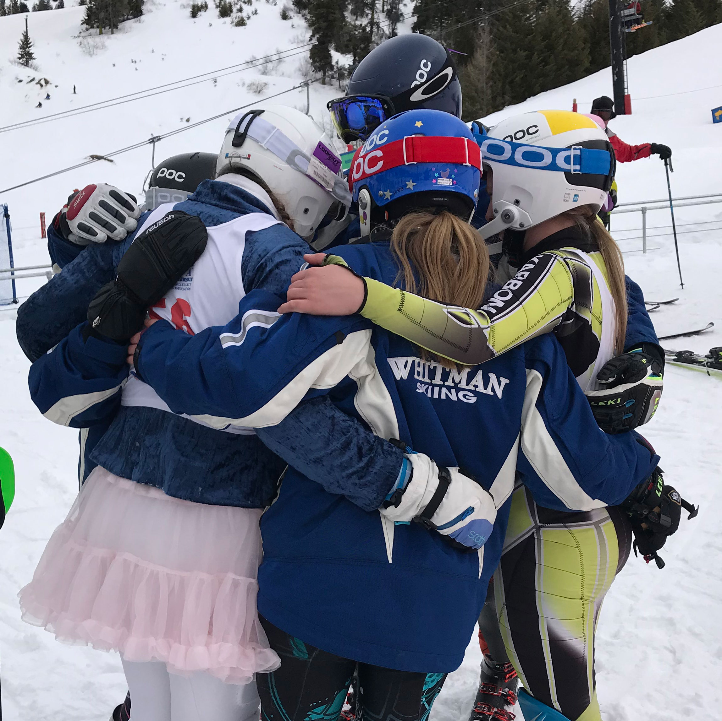 Whitman's Alpine Ski Team hugs before a race