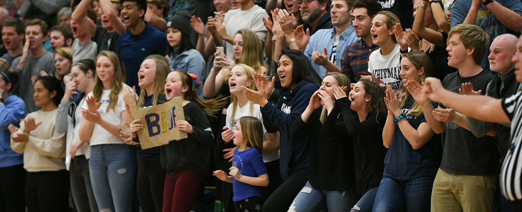Fans cheering the Whitman Blues