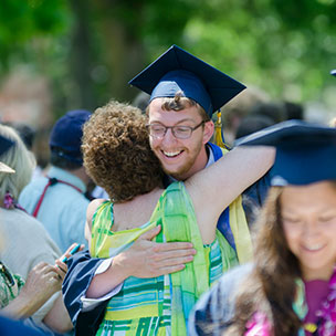 Family hugging during Commencement