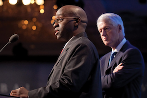 Ashifi Gogo speaks at the Dartmouth Innovation Program as former President Bill Clinton observes. Photo courtesy the Clinton Global Initiative.