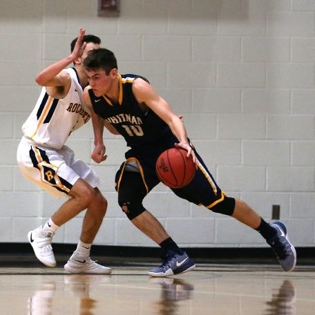 Whitman basketball player guarding Rochester player
