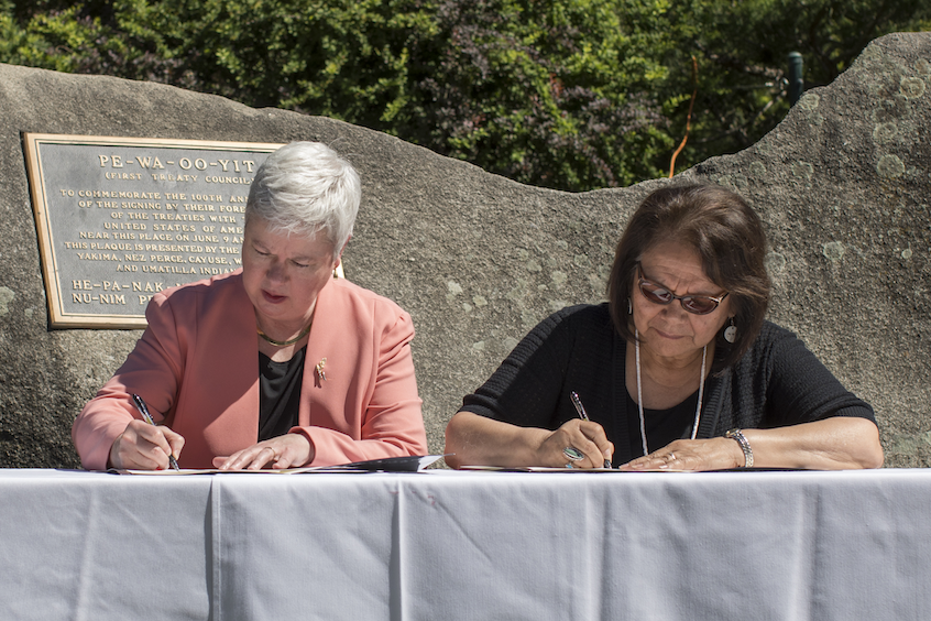 President Kathy Murray and Kathryn Brigham, secretary of the CTUIR Board of Trustees, sign the Memorandum of Understanding in June 2017.