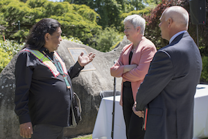 Confederated Tribes of the Umatilla Indian Reservation (CTUIR) Board Member Thomas Morning Owl (left), Whitman College President Kathleen Murray and Chair of the Whitman Board of Trustees Brad McMurchie '84 confer about the memorandum of understanding on May 19.