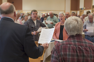 "Blake Ladenburg '17 (center left), senior fund chair and an economics major, and President Murray (center right) join the class of 1967 and Whitman staff in a rendition of the ""Whitman Hymn"" to conclude the luncheon."