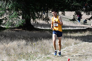 Carl Ye runs through a field.