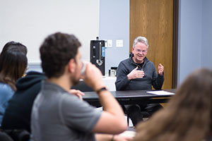 Tom Davis talks to students during a presentation in February 2020.