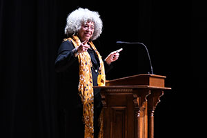 Angela Davis speaks at the podium.