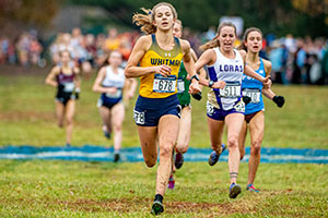 Whitney Rich runs in the cross country championships.
