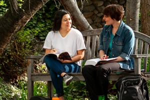 Whitman College student and faculty having a conversation outdoors