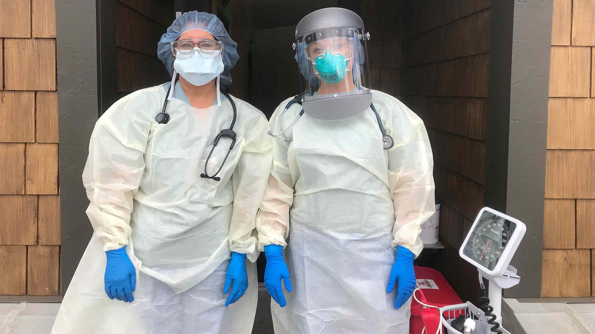 Two medical workers in full PPE gear
